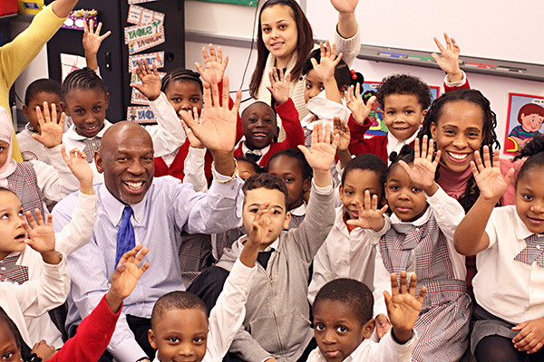 Geoffrey Canada in the classroom surrounded by young students